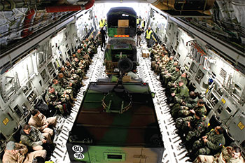 French military personnel and their vehicles are seen aboard a U.S. Air Force transport aircraft headed for Mali.