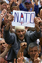Thousands of ethnic Albanians celebrate the arrival of French NATO troops in the town of Gnjilane, Kosovo.