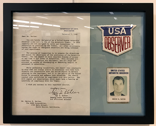 U.S. Antarctic Observer Letter to Merton Davies with Observer patch and ID, 1966-1967. Courtesy of the Merton E. Davies Family