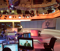 news stories about Iran and Israel showing in the Al Jazeera English newsroom
