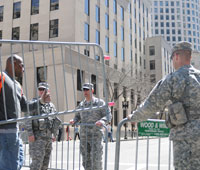 Massachusetts National Guardsmen help local and state authorities maintain a security cordon after the marathon bombings in Boston