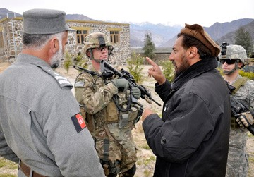U.S. Army Captain talks with the Nurgaram district sub-governor in Nuristan, Afghanistan, photo by CMSgt Richard Simonsen/U.S. Air Force