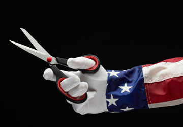 the hand of Uncle Sam holding scissors
