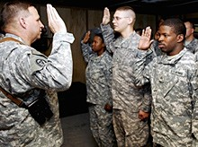 U.S. Army reservists taking re-enlistment oath, photo courtesy of U.S. Army/Staff Sgt. M. Alices
