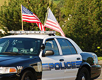 Police cruiser with American flags