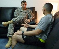 division psychiatrist listens as a soldier explains a problem, photo courtesy of Sgt. Jason Kemp/U.S. Army
