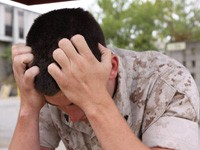 a marine feeling stressed, photo by Lance Cpl. Daniel Boothe/U.S. Marine Corps
