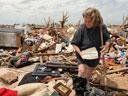 a woman sorting through Moore tornado aftermath, photo by Jocelyn Augustino/FEMA