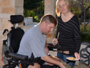 an injured serviceman and caretaker who is a servicewoman, photo by Lori Newman/U.S. Army