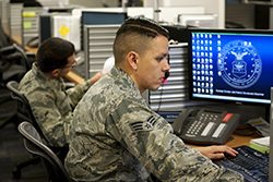 A senior airman working in defensive cyber operations