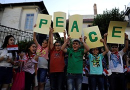 Children hold up letters spelling the word 'peace' during a day of activities and prayers at the Zaitoune historic church in old Damascus, Syria, June 1, 2016, photo by Omar Sanadiki/Reuters