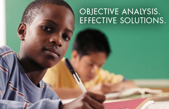 RAND Spotlight: Objective Analyis.  Effective Solutions.  Boy at desk in classroom.