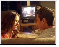 teen boy and girl in front of TV