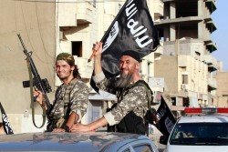 Islamic State fighters take part in a military parade along the streets of northern Raqqa province, Syria