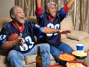 couple watching football on TV and cheering