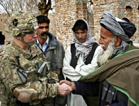 U.S Army Capt. and malik of the town of Bajawri shake hands outside a village mosque in Afghanistan's Parwan province, photo courtesy of U.S. DoD