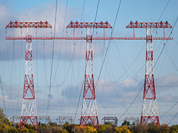 Group of transmission towers or power tower, electricity pylon, steel lattice tower, photo by Aloshin Evgeniy/AdobeStock