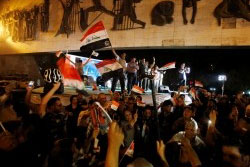 Iraqis celebrate as Prime Minister Haider al-Abadi announces victory over Islamic State in Mosul, in Baghdad, Iraq, July 10, 2017, photo by Wissm Al-Okili/Reuters