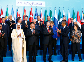 Members of the Group of 20 applaud during the G20 summit in Antalya, Turkey, November 15, 2015