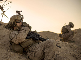 Marine Corps Sgt. Christian Carpenter relays commands during a tactical exercise to recover aircraft and personnel at an undisclosed location in Southwest Asia, January 25, 2016