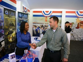 Kerry-Ann Moore, a veterans' advisor, meets with Army Capt. Jessie Felix at a military job fair in Ponte Vedra Beach, Florida, May 2, 2015