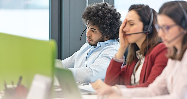 People working at a stressful customer service call center