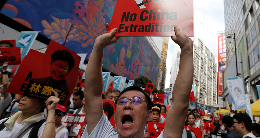 A demonstrator holds up a sign during a protest to demand authorities scrap a proposed extradition bill with China, in Hong Kong, China June 9, 2019
