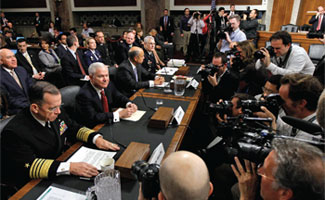 U.S. Joint Chiefs Chairman Admiral Mike Mullen, U.S. Secretary of Defense Robert Gates, Defense Department General Counsel Jeh Johnson, and General Carter Ham take their seats prior to testifying before the U.S. Senate Armed Services Committee's Don't Ask, Don't Tell policy hearing.