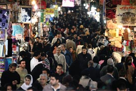 Iranians walk in Tehran's old bazaar.