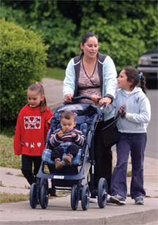Norma Arroyo walks with her children near their home in Vallejo, California.