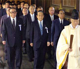 Japanese law-makers follow a Shinto priest at Tokyo's Yasukuni Shrine on August 15, 2007.