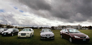 Repossessed vehicles sit beneath ominous skies in front of the Oregon Community Credit Union in Eugene, Oregon.