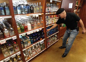 John TaJalle compares bottles of lower-priced vodka at a Seattle liquor store.