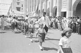 Muslim children march in a parade during official independence celebrations in Algiers, Algeria, on July 5, 1962.