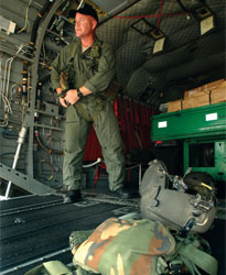 Sergeant Michael Allen prepares for flight in a Chinook helicopter.