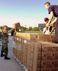 Nebraska National Guard crews load pallets of Meals Ready to Eat (MREs).