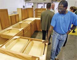 Inmate Alan Lee inspects finished cabinets at the Iowa State Penitentiary in Fort Madison, Iowa.