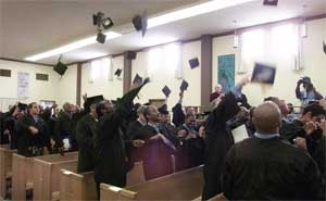 Graduates throw their mortarboards into the air at the conclusion of their graduation ceremony inside San Quentin prison in San Quentin, California.