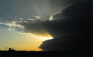 Rays of light pierce through storm clouds south of Palco, Kansas.