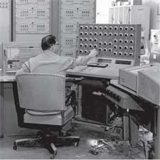 Eddie Hatten operates the Reeves Electronic Analog Computer (REAC) in 1959