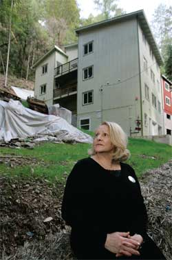 Nadia McCaffrey, president of the Patrick McCaffrey Foundation, sits in front of a proposed housing site for veterans in Guerneville, California.
