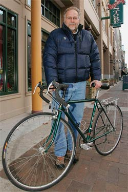 Biking commuter Jim Richards rolls into work at Mast General Store in Knoxville, Tennessee.