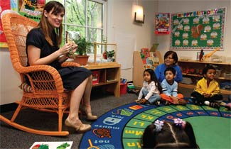 Actress Jennifer Garner reads to children at a Head Start program in Washington, D.C.