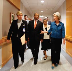 Health and Human Services Secretary Kathleen Sebelius tours the Tufts Medical Center in Boston with Massachusetts Governor Deval Patrick and Massachusetts Health and Human Services Secretary Judy Ann Bigby.
