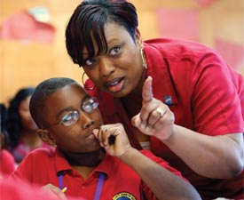 Teacher Trenise Duvernay talks with Corey Boudreaux while teaching fourth-grade math at the Alice M. Harte Charter School in New Orleans.
