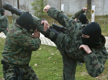 Bulgarian police special anti-terrorist unit members practice fighting in Sofia, November 14, 2002, not long before Bulgaria was invited to join NATO
