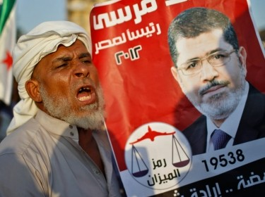 A supporter of Muslim Brotherhood's presidential candidate Morsi during a rally at Tahrir Square in Cairo June 22, 2012