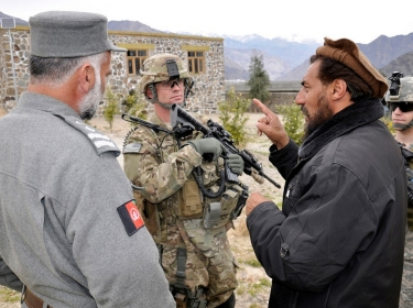 U.S. Army Captain talks with the Nurgaram district sub-governor in Nuristan, Afghanistan