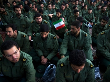 Revolutionary Guard members in Iranian Safir vehicle during a military parade in Tehran