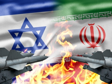 Israeli and Iranian flags, weapons, fire
